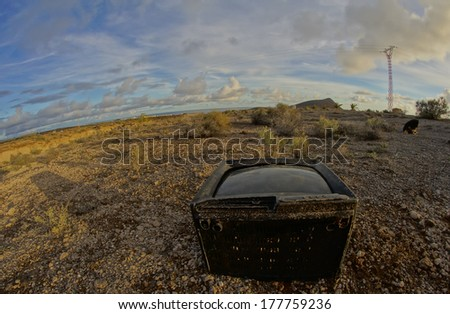 Hdr icture of Abandoned Broken Television in the Desert on a Cloudy Day - stock photo