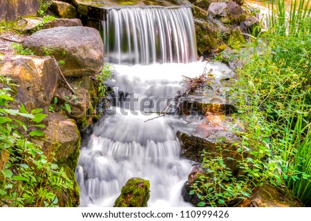 HDR image A Small cascading waterfall - stock photo