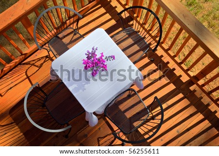 HDR Image of an Outdoor Breakfast Table on a Sunny Morning. - stock photo