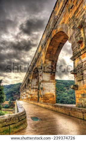 HDR image of Pont du Gard, ancient Roman aqueduct listed in UNESCO - stock photo