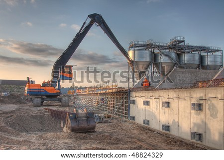 HDR of an Excavator - stock photo