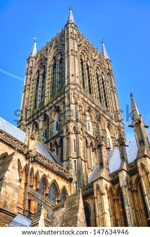 HDR of Lincoln Cathedral tower, UK showing architectural detail. - stock photo