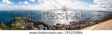 HDR Panorama of the Strait of Gibraltar  from Africa to Spain with harbor taken from the out of service British Gun post. Gibraltar, UK - stock photo
