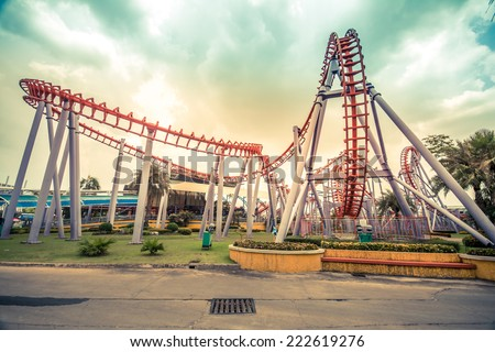 HDR photo of a  Colorful Looping Roller Coaster On A Beautiful Sunny Day - stock photo