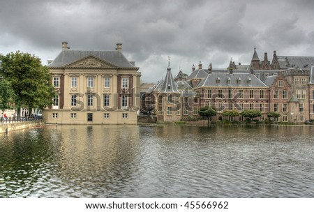 HDR photo of Royal Palace in Hague, Netherlands. Old architecture. Rainy, cloudy weather.