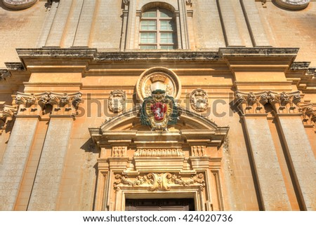 HDR photo of the entrance to the St. Peter & Paul Cathedral in the city of Mdina, in Malta - stock photo
