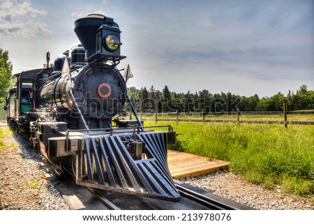 HDR rendering of a vintage locomotive steam engine with copy space. - stock photo