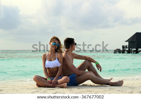 he and she on the beach - stock photo