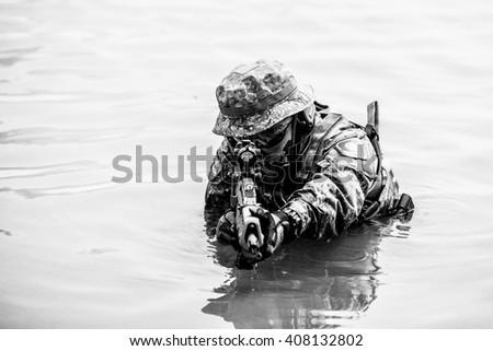 He is aim the gun forward with dark tone. - stock photo