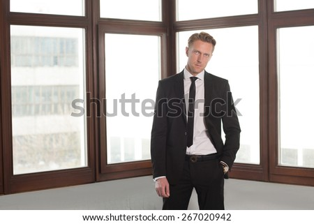 He is handsome and perfect worker. Portrait of businessman in office. - stock photo