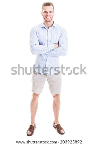 He is so confident! - Full length portrait of a sportive young man standing with his arms crossed isolated on white background - stock photo