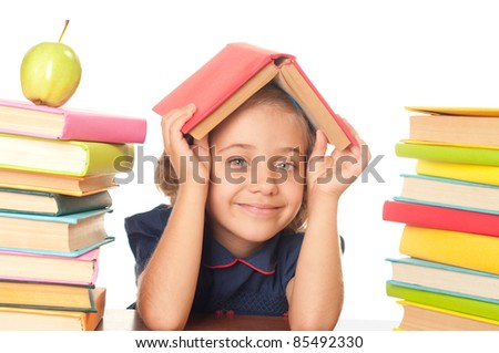 he nice school-girl with the book over white - stock photo
