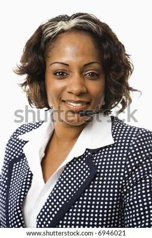 Head and shoulder of smiling businesswoman talking on telephone headset.
