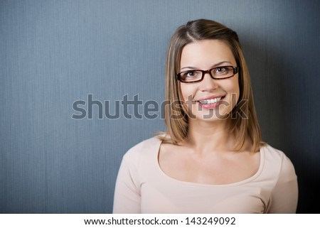 Head and shoulder portrait of brunette young woman with glasses - stock photo