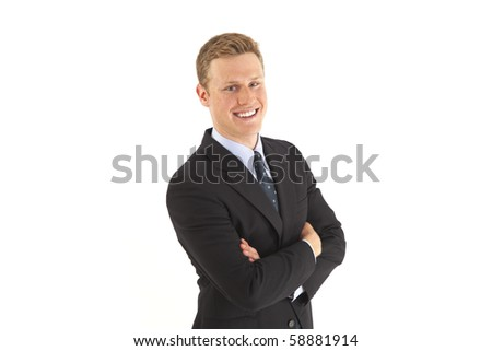 Head and shoulder portrait of smiling young businessman with arms crossed