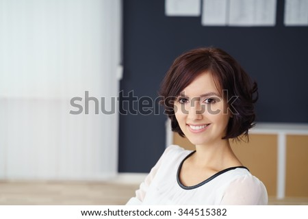 Head and Shoulder Shot of a Pretty Young Office Woman Looking at the Camera with Happy Facial Expression. - stock photo