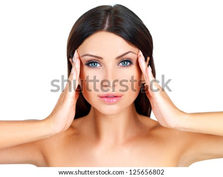 Head and shoulders beauty portrait of a naked beautiful woman massaging her temples with her fingertips isolated on white - stock photo