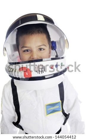"""Head and shoulders image of an elementary """"astronaut"""" in his uniform and helmet, with his visor opened.  On a white background. - stock photo"""