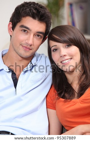 Head and shoulders of a young attractive couple