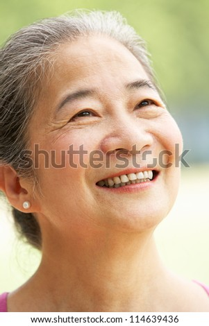 Head And Shoulders Portrait Of Attractive Chinese Senior Woman
