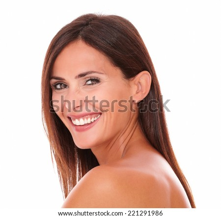 Head and shoulders portrait of happy adult woman laughing and looking at camera on isolated white background - stock photo