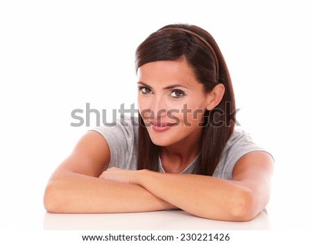 Head and shoulders portrait of lovely lady looking at camera and smiling on isolated studio - stock photo