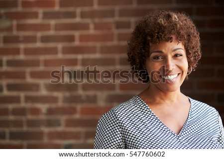 Head And Shoulders Portrait Of Mature Businesswoman