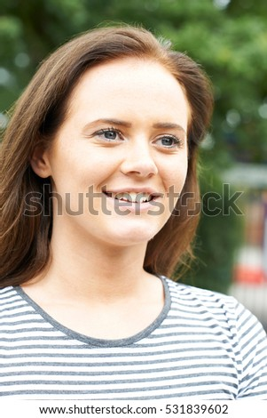 Head And Shoulders Portrait Of Smiling Teenage Girl