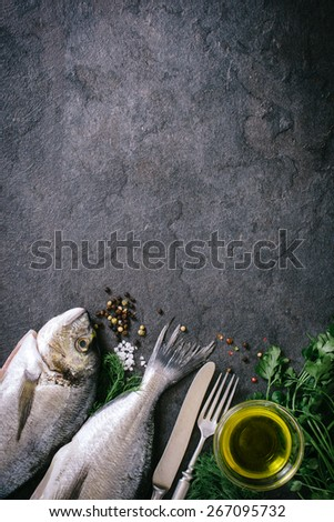 Head and tail of glithead fish and blank space on black background with blank space  - stock photo