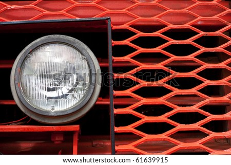 Head beam lamp and grill of vinatge giant mining truck. - stock photo