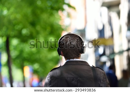 Head in silhouette with headphones - stock photo