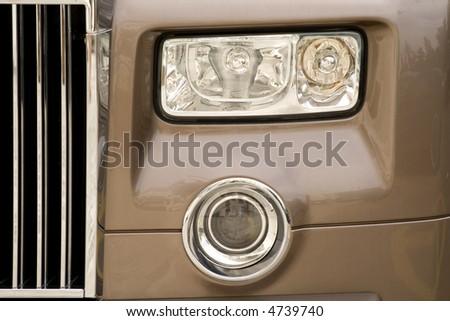 Head lights of a luxury car - stock photo