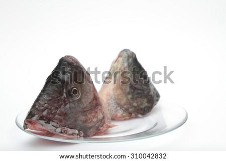 head of fish on white Background as jewish new year symbol ( Rosh Hashanah ) - stock photo
