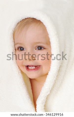 Head of  little girl in  white towel - stock photo