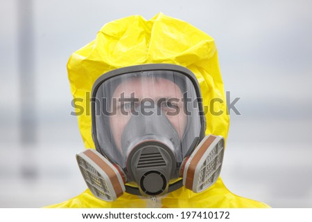 Head of man in modern gas mask - close up - stock photo
