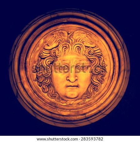Head of Medusa Gorgon, ancient marble relief in a round frame. The mythological character of the ancient period - face of Medusa, Istanbul museum. - stock photo