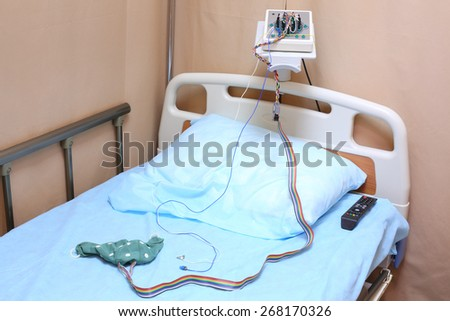 Head of the bed with a pillow and electroencephalograph in a hospital ward - stock photo