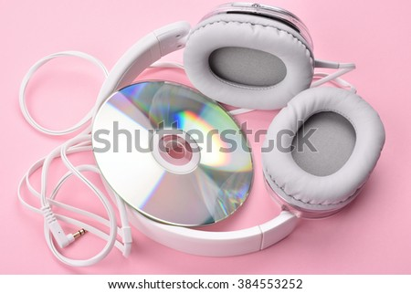 Head phones and CD on a Pink Background - stock photo