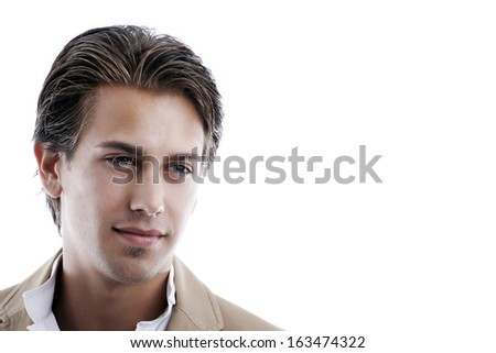 Head portrait of a handsome young man lost in thought staring thoughtfully downwards with a serious expression on white with copy space. - stock photo