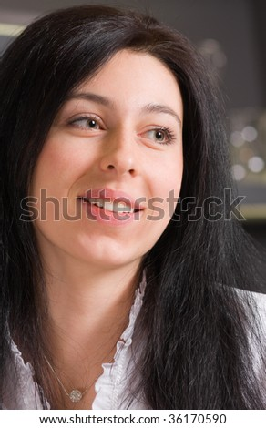 Head portrait of smiling brunette girl; shallow DOF