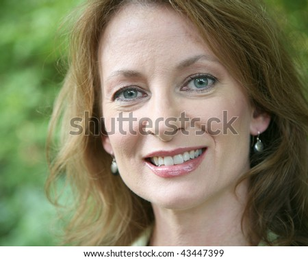 Head shot of a middle aged woman - stock photo
