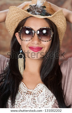 Head shot of a model in a cowboy hat.