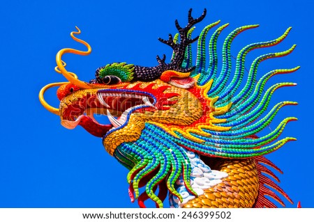 Head shot of colorful dragon statue with blue sky at public park, Thailand. - stock photo