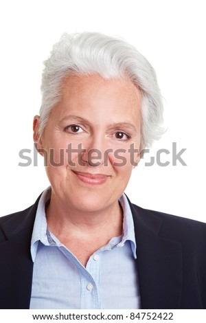 Head shot of smiling senior woman with grey hair - stock photo
