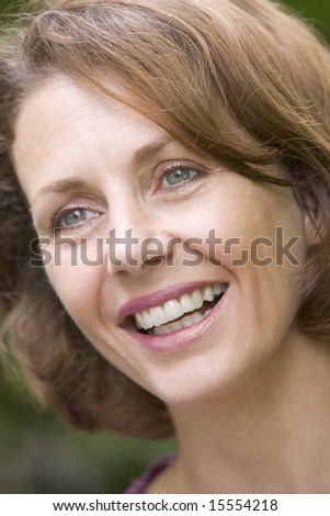 Head shot of woman smiling - stock photo