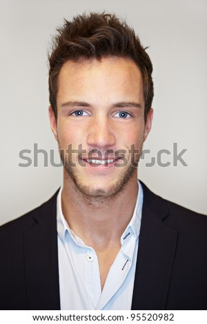 Head shot of young business man smiling - stock photo
