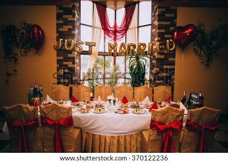 Head table for the newlyweds at the wedding hall - stock photo