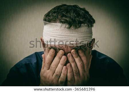 Head tied up by bandage - stock photo