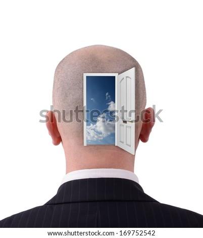 Head with  open doorway to reveal inside - stock photo