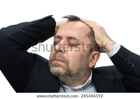 Headache. Portrait of an middle age man with face closed by hands. Isolated on white  - stock photo